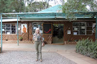 Joany standing in front of the Kazuri Bead Factory store