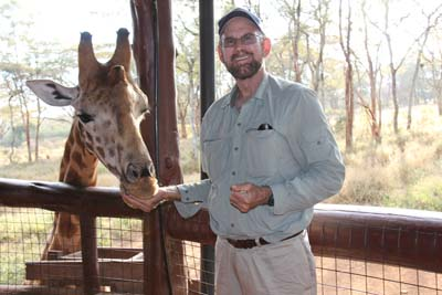 a Picture of Dave feeding a Giraffe at the Langata Giraffe Center