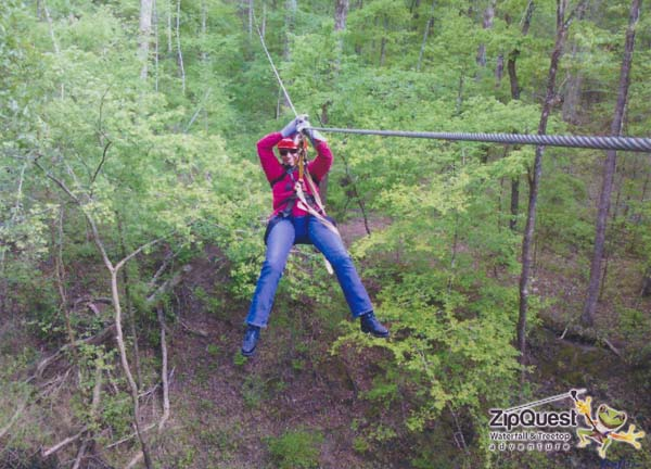 a Picture of Joany zip lining at ZipQuest, Fayetteville, NC